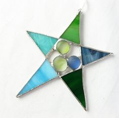 Stained Glass Star Suncatcher Ornament Green Blue This quirky star is created from green and blue glass in various shades. Three frosted