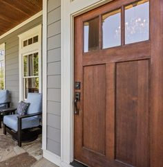 Wood front door with glass, gray siding with white trim, covered porch. Front Doors With Windows, Wood Front Doors, Front Door Colors, White Trim Wood Doors, Front Door With Glass, Wood Exterior Door, Exterior Front Doors, Grey Exterior, Exterior Paint