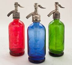 These beautiful half liter bottles have original metal spouts with colorful glass bases molded from the original 1940s cast that was found in an old seltzer factory in Argentina. Hand-restored in Argentina.