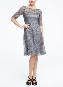 Ultra-feminine and chic, this lovely lace bridesmaids dress will be a staple in your wardrobe for seasons to come!  Contrast corded lace dress features illusion neckline and elbow length sleeves.  V-cut open back.  Full a-line skirt.  Fully lined. Back zip. Imported polyester. Dry clean only.