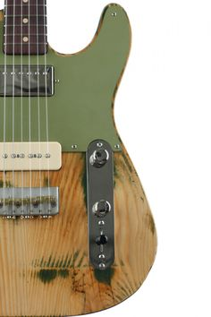 like the raw wood and colored pickguard, wish it was a tele pickup in the bridge instead of p90