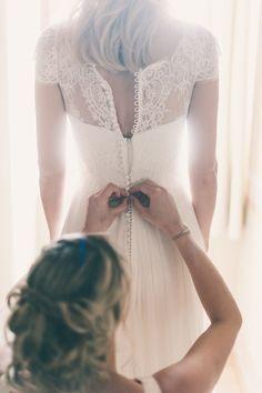 wedding dress buttons, photo by Lisa Poggi http://ruffledblog.com/tuscany-destination-wedding #weddingdress #bridal