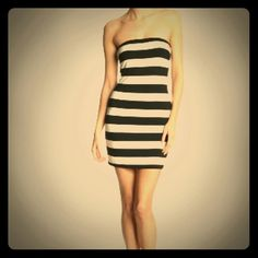 Trina Turk black & whited striped strapless dress New with tags, Trina Turk strapless striped dress. Has a black lining.  Stretchy material (65% viscone, 5% elastane, 10%; lining: 90% modal, 10% spandex). Made in California USA!  The only defect found is on backside near bottom of dress there are 2 small stains (looks like a pen mark, but I didn't want to mess with it since its not that noticable) Accepting offers, and always discount with bundles! Trina Turk Dresses Mini