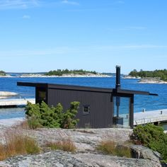 Margen Wigow Arkitektkontor models blackened timber holiday home on Swedish fishing huts