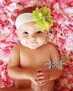 soft nylon headband.  I'd like the baby too!!  She's adorable!
