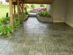 Stamped concrete patio for walk out basement and under the deck.