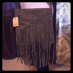 Boho Hippie Faux Suede Fringe Messenger Bag  Photos are taken in the best possible lighting available to me. Although color may be lighter than pictured. I work hard on these listings to give you an idea of what this garment will look like when worn and styled. Most everything is gently used in pre-owned condition, at the bottom of each listing will be a few notes about the individual item. Please ask me any questions. Accessories not included. *Brand new with tags. Price is firm unless…