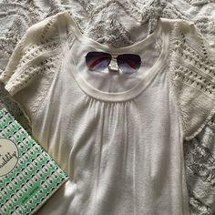 Cream sweater This has been loved but still in good condition. Reasonable offers accepted. Would love to bundle. Size large but could could fit a small size it's a loose style and has maybe shrunk a little. The detailing on the shelves are beautiful. Anthropologie Tops
