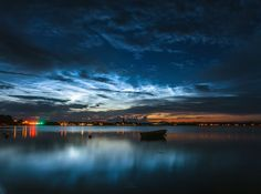 """Electric-blue """"night-shining"""" clouds can be seen swirling over the skyline of Nykøbing Mors in Denmark on July 1, 2016. Credit: Ruslan Merzlyakov/RMS photography"""