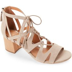Elie Tahari Taupe Burano Tasseled Open Toe Ghillie Sandals ($120) ❤ liked on Polyvore featuring shoes, sandals, beige, wooden shoes, beige shoes, color block sandals, laced sandals and zipper sandals