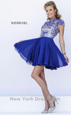 Light up the room in this enchanting evening dress by Sherri Hill 1938. The illusion bodice has a high neckline and sparkling cap sleeves embellished with