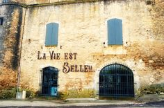 "Ménerbes, small village with some old buildings worth mentioning, such as this one: ""Life is beautiful""."