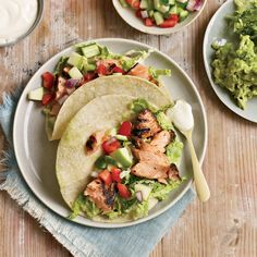 Chipotle-Rubbed Salmon Tacos   These tacos are a great way to eat heart-healthy salmon; Deborah Schneider, a huge advocate of cooking with sustainable fish, prefers wild Alaskan salmon. She tops the fish with crunchy cabbage—a traditional taco garnish that has all kinds of vitamins and minerals, like vitamins A and C and calcium. The tangy apple-cucumber salsa is juicy, crisp and full of fiber.