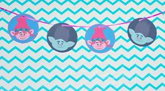 trolls party printables are fun for a movie night or trolls party. Make garlands, gift tags, cupcake toppers, and centerpieces with these printables!