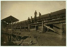 Young boys work around and on these coal cars, 1910 - Heartbreaking Photographs of Child Labour In USA  Best of Web Shrine