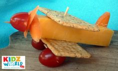 Grape tomatoes, baby carrot slices, cheese, and crackers make this adorable little propeller plane.