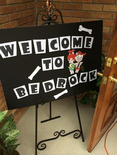 Welcome sign for Flintstones party