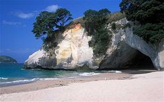 Cathedral Cove, New Zealand    North Island's Coromandel Peninsula is an ecological paradise renowned for its marine wildlife and beaches, the most beautiful of which is Cathedral Cove. Whether taking the coastal path from Hahei or arriving by boat or kayak, time a visit here with low tide for the essential photo opportunity under the spectacular limestone archway that divides the beach.           Share      6      Facebook      1      Twi