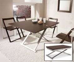Flexy Coffee/Dining Table Calligaris. Available in wenge wood top and satin steel frame.  Adjusts to 7 different heights from coffee table to dining table and top doubles in size. Available at POMP HOME in Culver City, CA www.pomphome.com