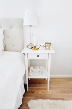 White minimal nightstand with lamp and candle