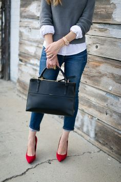 grey cropped sweater over a white shirt, red pumps light up the whole outfit, great casual work outfit for fall