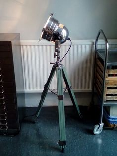 Restored par 56 stage floor light on a restored and polished 1970's telescope tripod. By Mike Bainbridge.