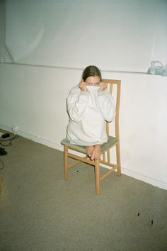 Corinne Day, Kate in jumper on chair