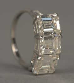 : Platinum three stone diamond ring set with three, Lot Number: 0068, Starting Bid: $7,500, Auctioneer: Nadeau's Auction Gallery, Auction: Important Annual New Years Day Auction, Date: January 1st, 2017 GMT