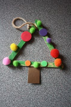 Christmas crafts for little people. Popsicle sticks and pom poms is just one idea on this page. Very simple crafts for small kids.