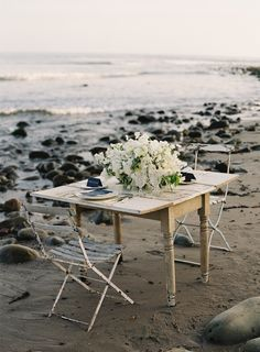 Romantic beach table setting for two (would be so pretty as a surprise engagement dinner set-up).