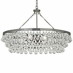 The beauty of Bling on a truly grand scale. The Robert Abbey Bling Large Chandelier features numerous round and pear-shaped glass drops draped in multiple layers around the wide (nearly 3 feet around) metal frame. These drops create a decidedly appetizing sparkle that's ideal for modern dining rooms. Available in two finishes. Gatsby-inspired lighting. #chandelier @Lumens Light + Living #lighting #freshfinds #housetrends