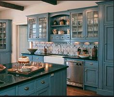 Love the colour.. If you have to have painted cupboards, anything but white please..