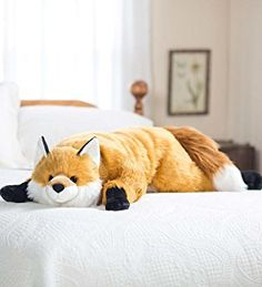 "Fun, fuzzy and four feet long! Curl up with a cuddly critter pillow and relax in snuggly comfort. Our friendly fox body pillow is crafted with super-soft, super-dense ""fur"" fibers. Beaded eyes and a perky nose gives him lots of personality. Giant Plush, Hug Pillow, Friendly Fox, Fox Decor, Pet Fox, Kids Pillows, Throw Pillows, Decorative Pillows, Decoration"