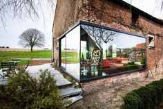 Incredible Brown Brick Wall And Glass Wall Design In New Home Architecture Decor With Green Yard View