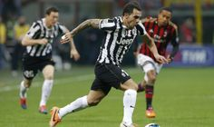 Juventus\' Tevez controls the ball during the Italian Serie A soccer match against AC Milan at the San Siro stadium in Milan