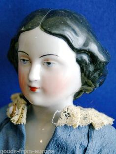 antique-german-Jenny-Lind-china-head-doll-with-molded-bun