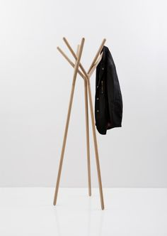greek designer yiannis ghikas has created the tri-foot coat hanger 'game of trust'