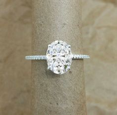 My favorite- Perfect oval engagement ring; focus on stone with elegant thin diamond band. I LOVE how the focus is on the diamond with the understated band as an accent.