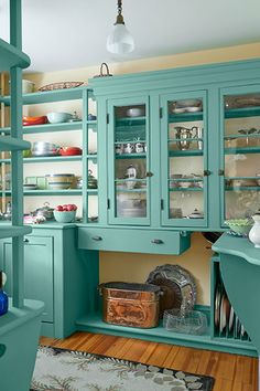 A colorful palette refreshes the walk-in pantry, with its original shelves and glass-front cabinets, of this 1850s Italianette.