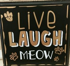 """Wall plaque. """"Live, Laugh,  Meow"""". Found at Big Lots"""