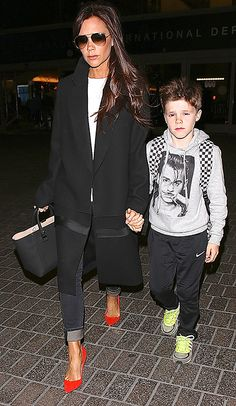 Victoria Beckham - always holding a hand. Lovely