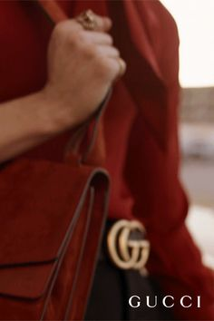 First shown on the Fall Winter 2015 runway, the Gucci Dionysus messenger bag is crafted from a single piece of specially worked suede, making it lightweight but durable. Unlined and with hand-painted edges, it features an adjustable shoulder strap and the season's signature engraved tiger-head hardware.