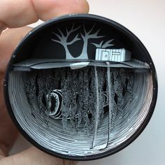 Dioramas with Paper Cutouts in Recycled Containers, come see how it is done. To see more art and information about Jim Doran click the image. Alien Drawings, Pop Up Art, Shadow Box Art, Matchbox Art, Lapsang Souchong Tea, Cardboard Art, Small Sculptures, Origami, Art Archive
