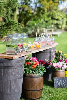 Impress your party guests with your very own garden It's easy to create using two barrels and a piece of wood to create the counter top.