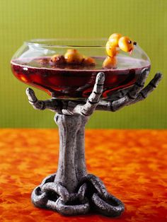 The spooky snake -- made from a string of kumquats -- offers a festive touch to this fruity concoction. A large bottle of lemon-lime soda adds just the right amount of fizz.