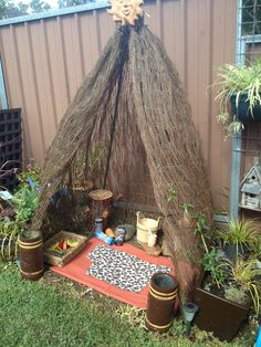 An easy made play space. The passionfruit vines planted on each side will grow and cover the tepee frame to create a evergreen hideaway where children's imaginations can wander