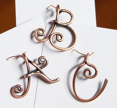 ***Please specify desired letter. This listing is for ONE letter pendant.*** Each letter initial is formed out of thick copper wire. Each letter will vary in size but is generally an inch tall. This listing is for one pendant in a letter of your choice. To view a sample of all the letters, please visit my Etsy shops section titled Personalized Jewelry.