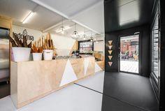 mode:lina envelops ice cream shop in poland with white sport cones