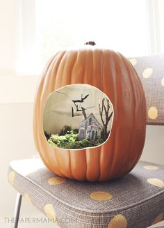 We love miniatures, so naturally this terrarium made out of a foam pumpkin caught our eye. You could even pop a couple of plants in there and make it a fairy garden.  Get the tutorial at The Paper Mama.   - CountryLiving.com