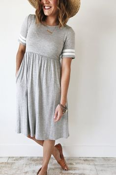 Grey Midi Dress Relaxed Sleeve Ivory Collegiate Stripes Hidden Hip Pockets Gathered Empire Waist Also Available in Seafoam Model is + Wearing a Small View Size Chart Modest Dresses, Modest Outfits, Modest Fashion, Women's Fashion Dresses, Pretty Dresses, Dress Outfits, Casual Dresses, Casual Outfits, Cute Outfits